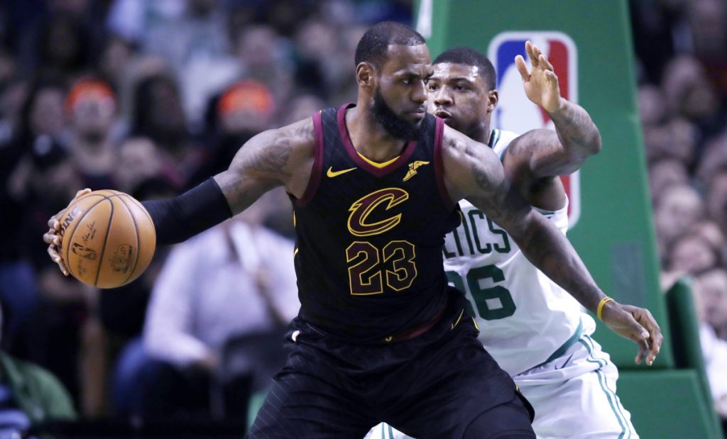 AP file photo In this January photo, Cleveland Cavaliers forward LeBron James (23) works the ball inside during the second quarter of a game against the Boston Celtics in Boston. There haven't been any championship banners raised into Boston's hallowed rafters since 2008. James won't let go of the rope. He has bounced the Celtics from the playoffs four times in the past seven years and Cleveland's megastar carries a six-game winning streak at Boston into this year's Eastern Conference finals, which open Sunday at TD Garden.