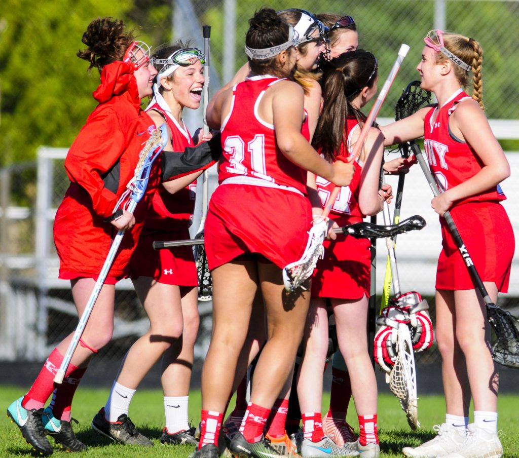 The Cony girls lacrosse team celebrates after beating Gardiner 13-9 Friday at Hoch Field in Gardiner.