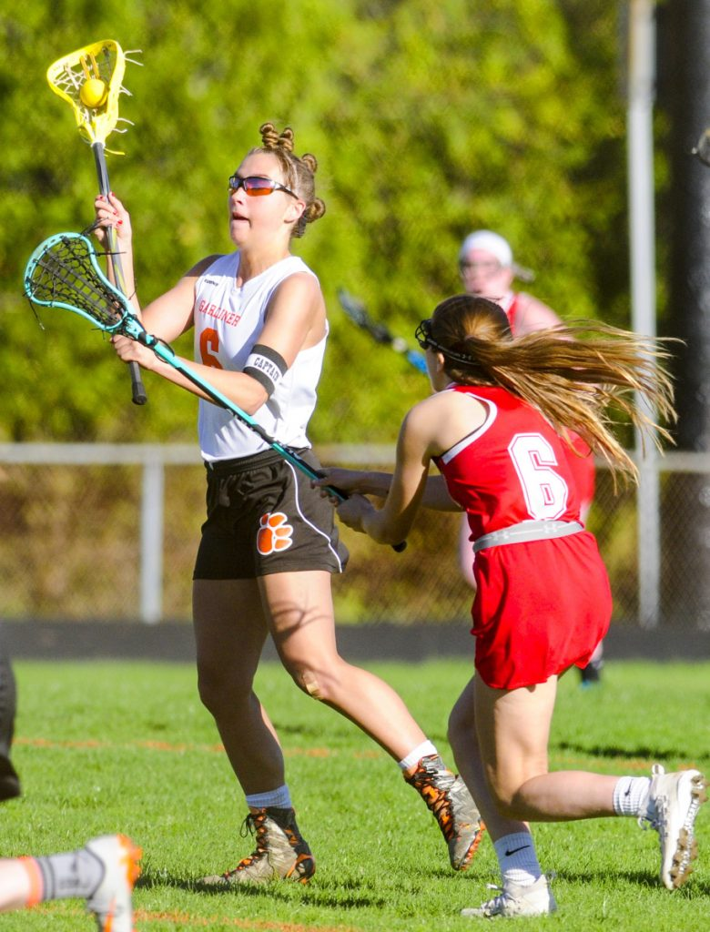 Gardiner's Anna Chadwick, left, passes as Cony's Sydney Avery defends during a game Friday at Hoch Field in Gardiner.