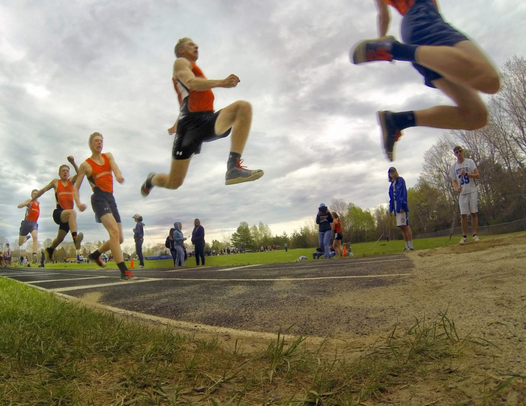 Skowhegan senior Kyle Jacques completes a triple jump during a track and field meet Thursday at Erskine Academy in South China.