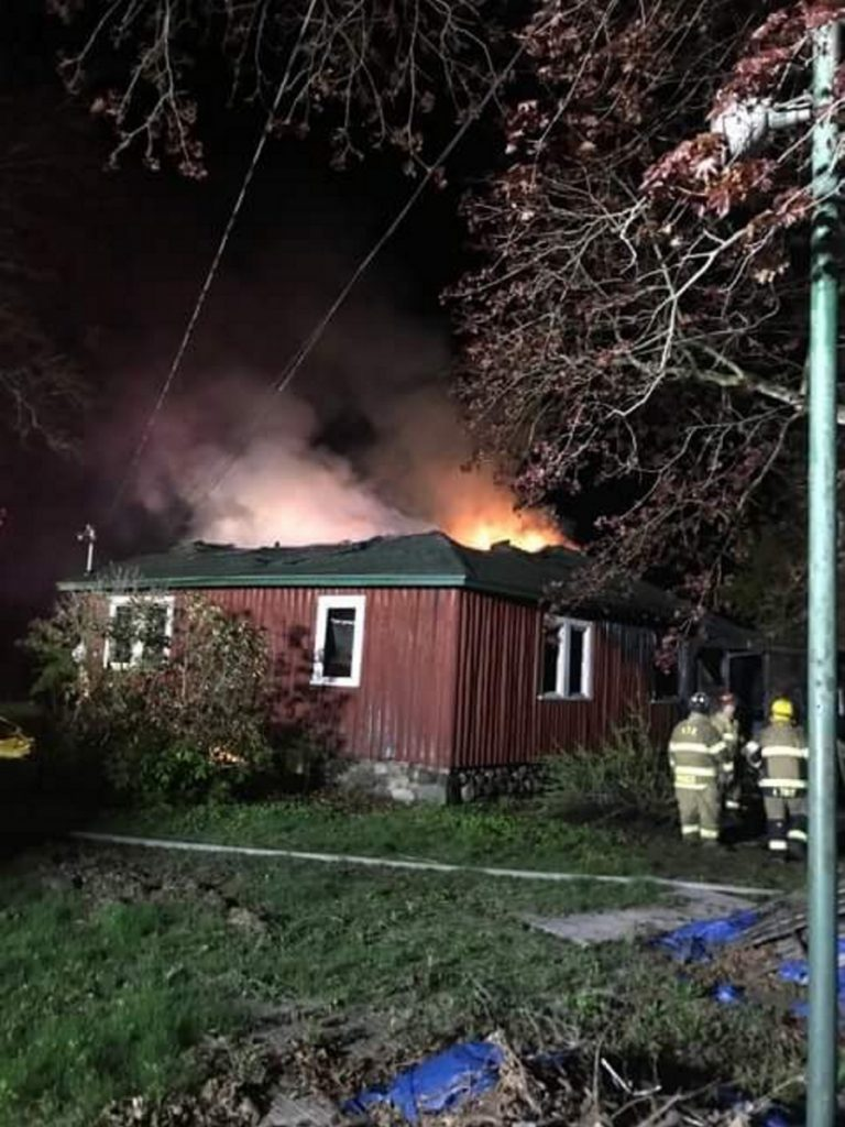 Firefighters work at the scene of a house fire that began late Friday night on Riverside Drive in Vassalboro,