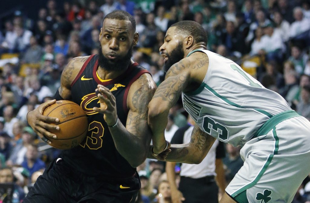 In this February 11 photo, Cleveland's LeBron James (23) drives against Boston's Marcus Morris (13) during the third quarter of a game in Boston. They both took winding paths to get here, but the Cavaliers and Celtics are back in the Eastern Conference finals for the second straight season. James is looking to join an elite list of players to appear in eight consecutive NBA finals.