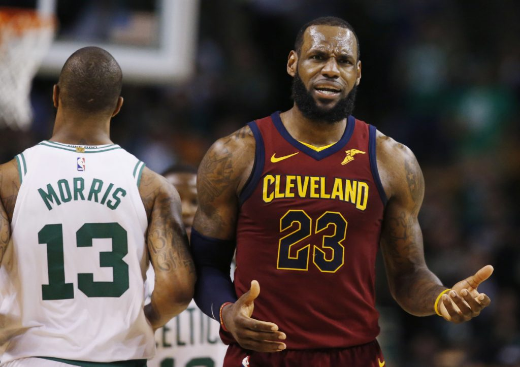 Cleveland Cavaliers forward LeBron James (23) reacts next to Boston Celtics forward Marcus Morris (13) during the third quarter of Game 1 of the Eastern Conference Finals on Sunday in Boston.