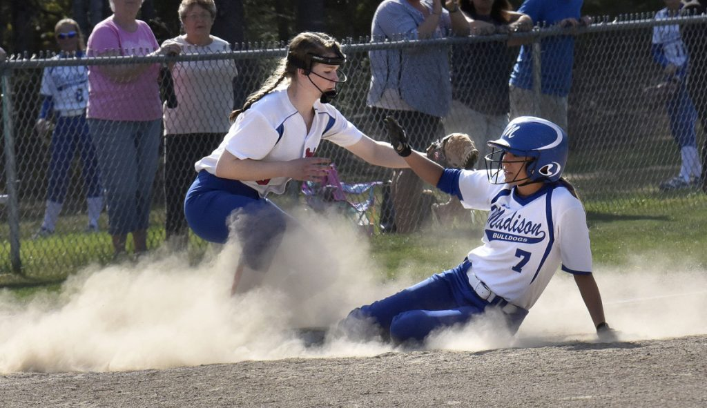Madison senior Sydney LeBlanc slides into third base as Oak Hill infielder Julia Noel fields throw during a Mountain Valley Conference game Monday afternoon in Madison.
