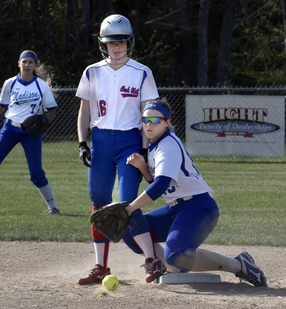 Oak Hill baserunner Rylea Swan makes it to second base as Madison's Marah Hall fields a throw during a Mountain Valley Conference game Monday afternoon in Madison.