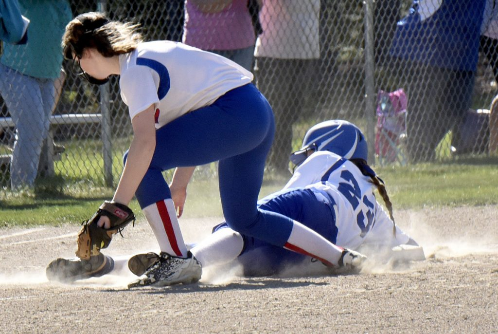 Madison baserunner Katie Worthen slides safely into third base as Oak Hill's Julia Noel fields the ball during a Mountain Valley Conference game Monday in Madison.