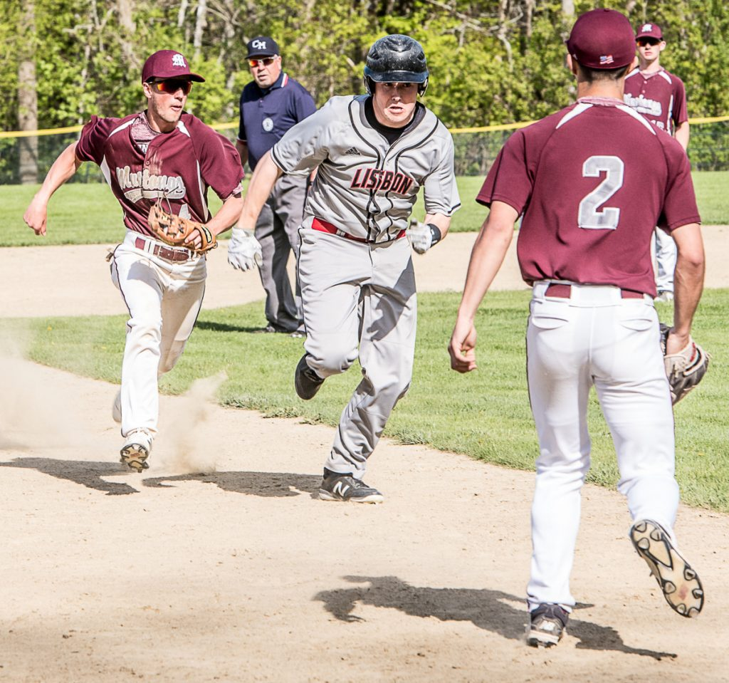 Lisbon baserunner Jonah Sautter is chased in a rundown by Monmouth infielder Nick Dovinski during a game Monday in Monmouth.