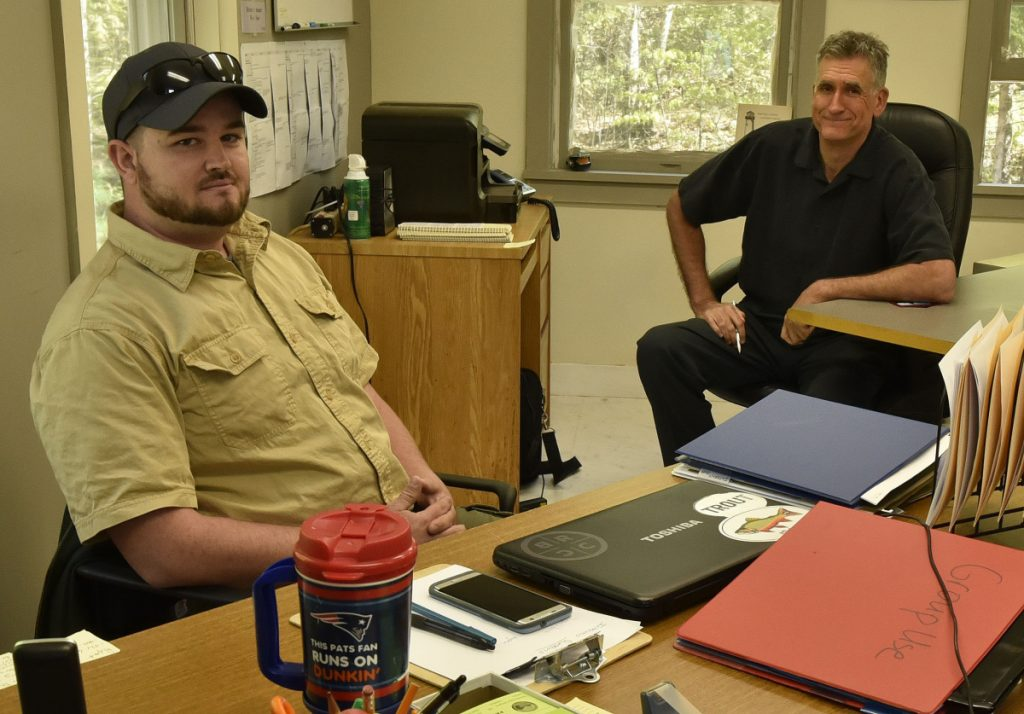 Lake George Regional Park resource manager Justin Spencer, left, and chief administrator Darryll White sit in the park headquarters office  ednesday in Canaan. White says Spencer's organizational skills and leadership experience fit well with his qualities as an initiator and visionary.