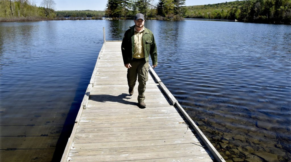 Lake George Regional Park resource manager Justin Spencer walks off the boat ramp Wednesday after inspecting it for the upcoming season at the east side of the park in Canaan. Spencer served two combat tours in Afghanistan and studies conservation law enforcement at Unity College.