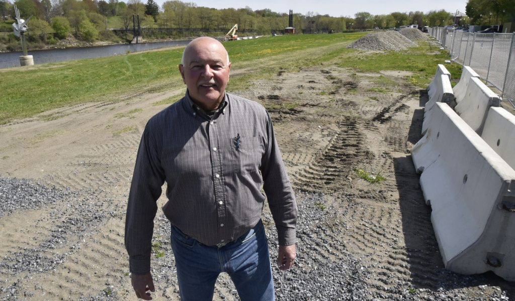 Waterville Public Works Director Mark Turner stands on Wednesday at Head of Falls in Waterville, where additional parking and a boardwalk will be built for the new $1.5 million Riverwalk project.
