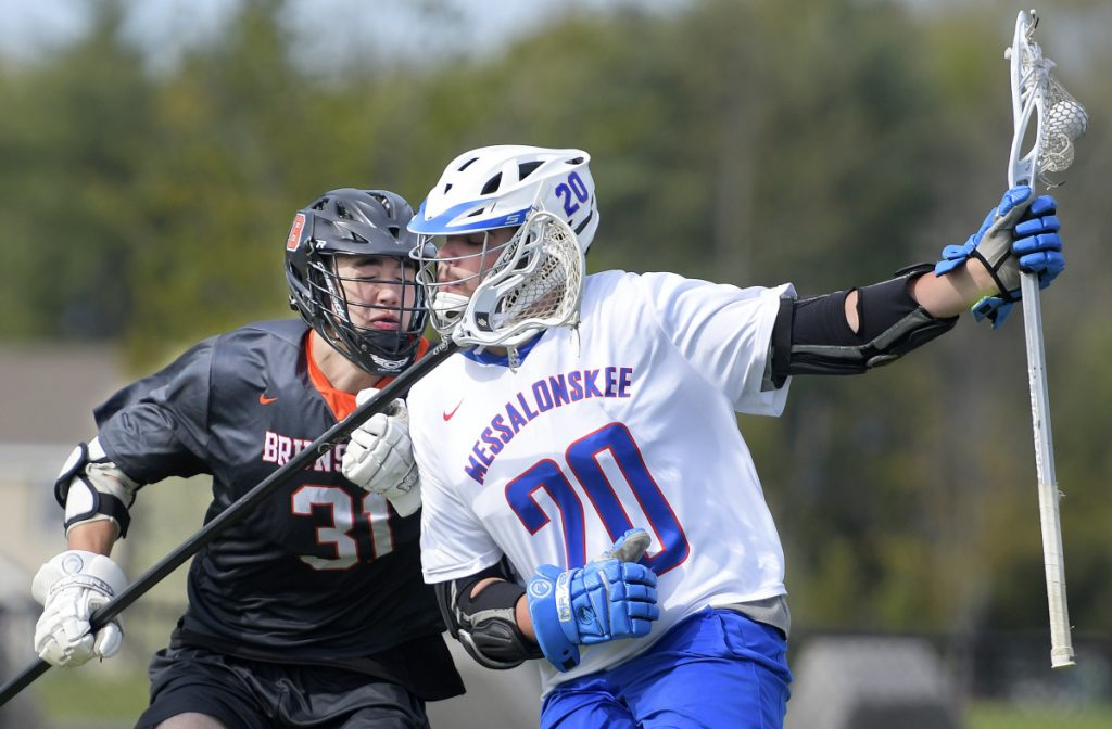 Messalonskee's Colin Kinney, right, gets clipped by Brunswick's Sam Dorval during a game Wednesday in Waterville.