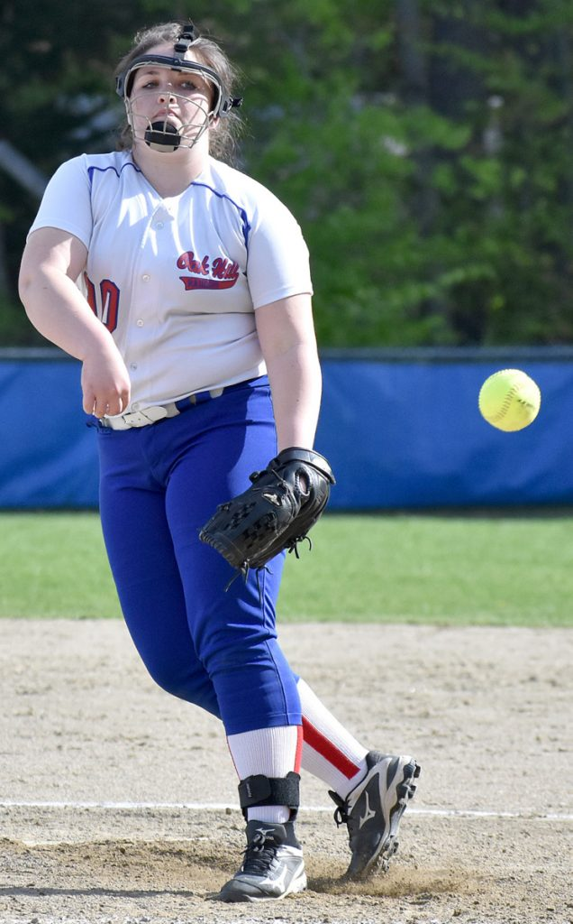 Oak Hill starting pitcher Molly Flaherty tracks her pitch during a win over Hall-Dale on Wednesday in Wales.