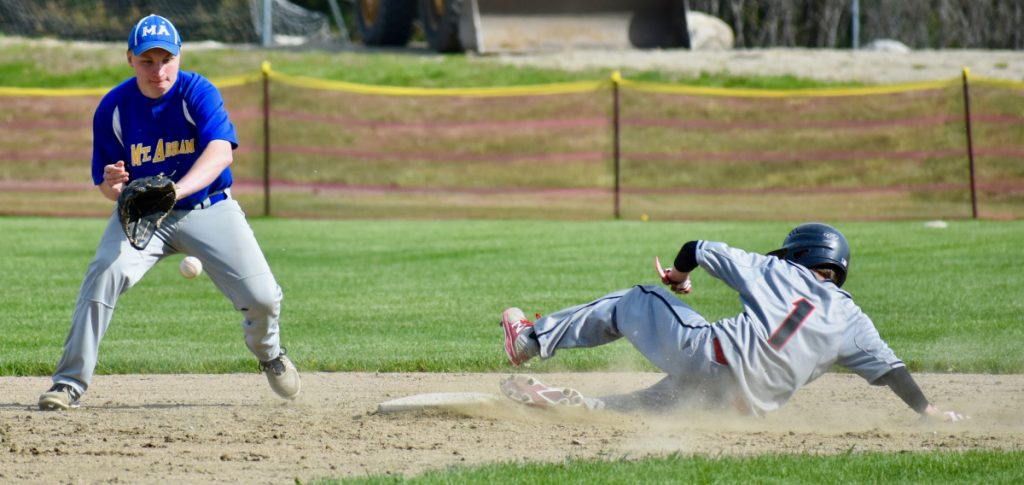 Mt. Abram second baseman Bryce Werzanski waits for the ball as Lisbon's Nick Austin slides safely into the bag.