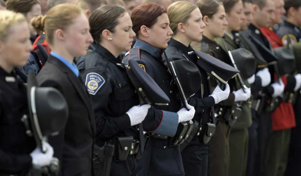 Law enforcement officers observe a moment of silence Thursday for Maine officers who died in the line of duty during the annual ceremony at the Maine Law Enforcement Officer's Memorial in Augusta.