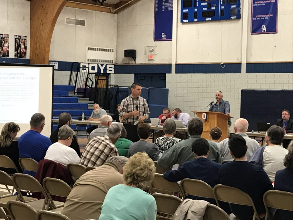 Litchfield resident Dave Lary speaks at the district budget meeting of Regional School Unit 4 on Wednesday at Oak Hill High School. Lary expressed frustration with the district's funding formula, which he said places an unfair amount of the tax burden on Litchfield.