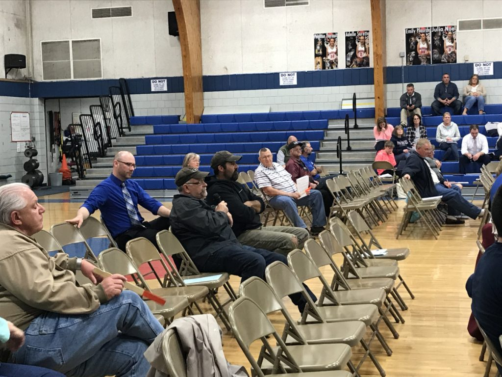 Mark Russell, chairman of the Litchfield Select Board, speaks at the district budget meeting of Regional School Unit 4 on Wednesday at Oak Hill High School. Russell expressed frustration with the district's funding formula, which he said places an unfair amount of the tax burden on Litchfield, and unsuccessfully proposed multiple amendments to lower the proposed budget.