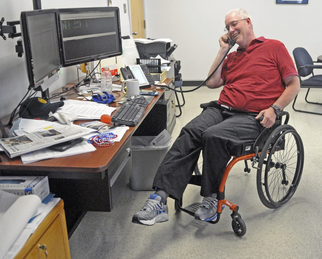 Augusta Police Chief Robert Gregoire does leg lift exercises while talking on the phone in his manual wheelchair on July 9, 2015, at the department headquarters in Augusta. Gregoire announced that he is retiring at the end of May. He has been with the Augusta Police Department since he was 22 years old.