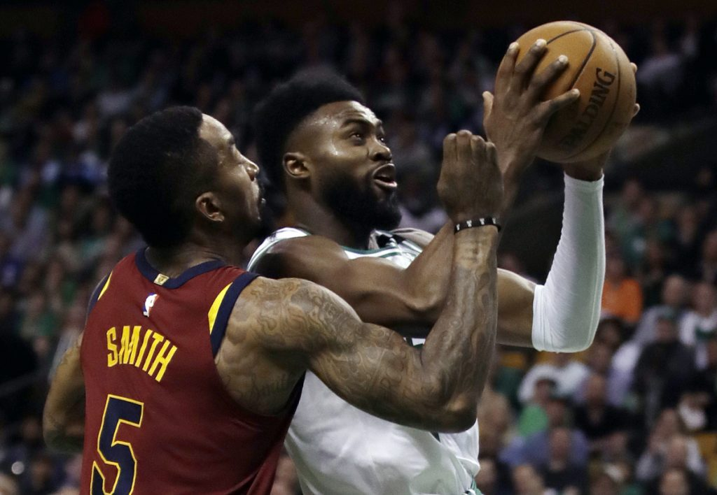 Boston Celtics guard Jaylen Brown, right, tries to drive against Cleveland Cavaliers guard JR Smith (5) during the second half of Game 2 of the Eastern Conference finals on Tuesday in Boston.