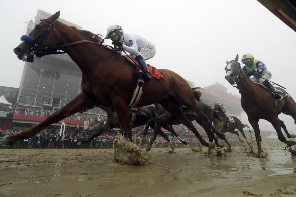 Justify with Mike Smith atop wins the the 143rd Preakness Stakes at Pimlico race course on Saturday in Baltimore.