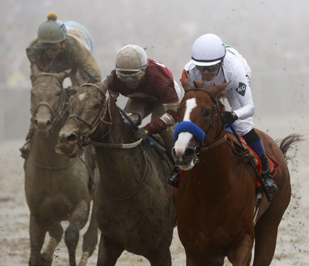 Justify with Mike Smith atop, right, wins the 143rd Preakness Stakes on Saturday at Pimlico race track in Baltimore. Justify will have a shot at the Triple Crown at the upcoming Belmont Stakes.