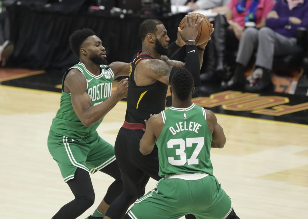 Boston's Semi Ojeleye (37) and Jaylen Brown, left, double-team Cleveland Cavaliers forward LeBron James, center, in the second half of Game 3 of the NBA Eastern Conference finals on Saturday in Cleveland.