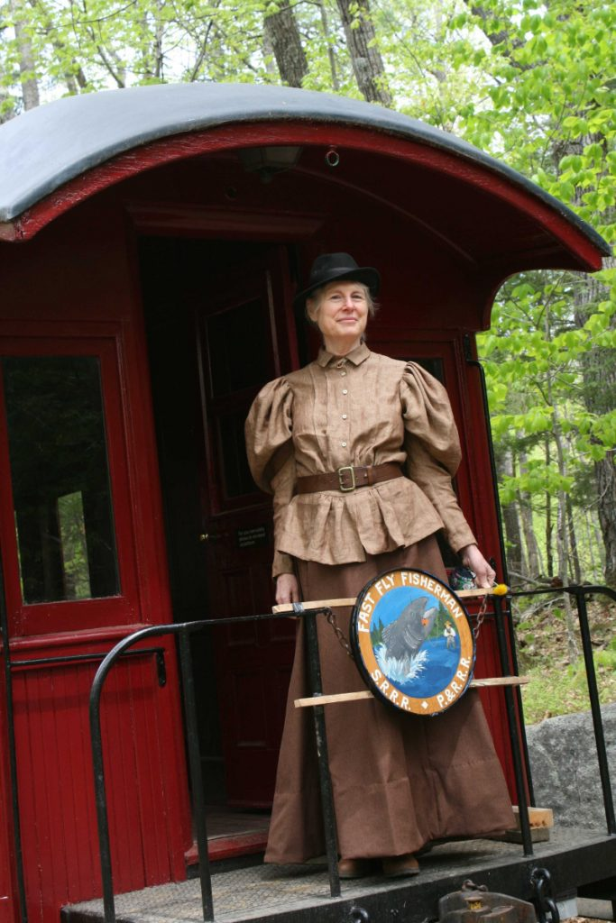 "Cornelia ""Fly Rod"" Crosby, portrayed by Pam Matthews, of Phillips, rode with visitors Saturday morning at the Sandy River & Rangeley Lakes Railroad Museum to the roundhouse and back during the inaugural Fly Rod Crosby Days at Fox Carleton Pond Sporting Camps in Phillips."