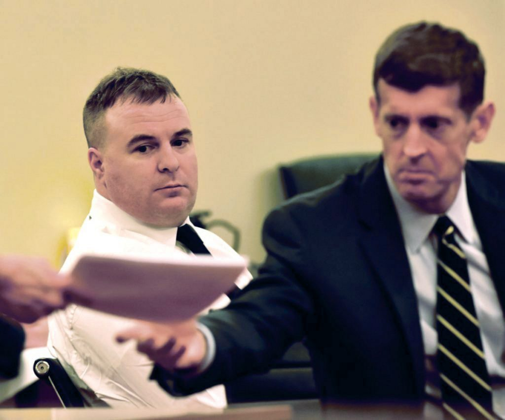 Defendant Jeremy Clement, left, watches as his attorney, Walter McKee, receives a court document Monday during the first day of his jury trial on charges of attempted murder in Kennebec County Superior Court in Augusta.