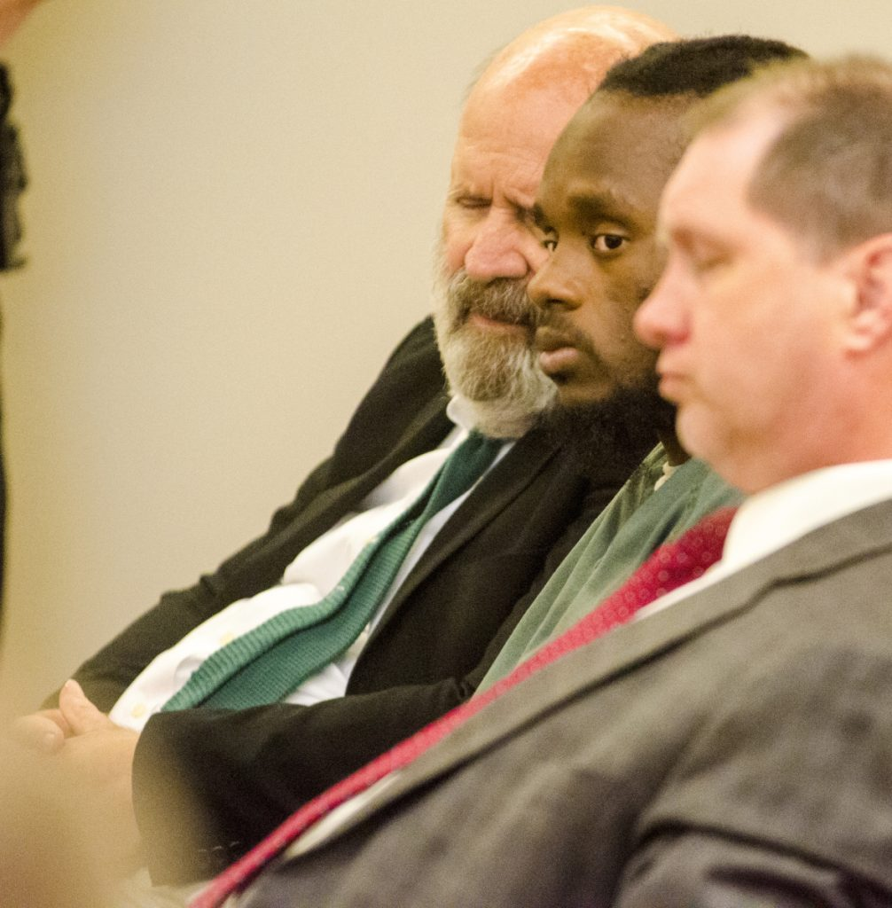 Translator John Roy, left, Aubrey Armstrong and defense attorney Brad Grant listen to the state's closing argument on Tuesday at the Capital Judicial Center in Augusta. Armstrong, charged with murder, has been using an interpreter to translate between English and Guyanese Creole.