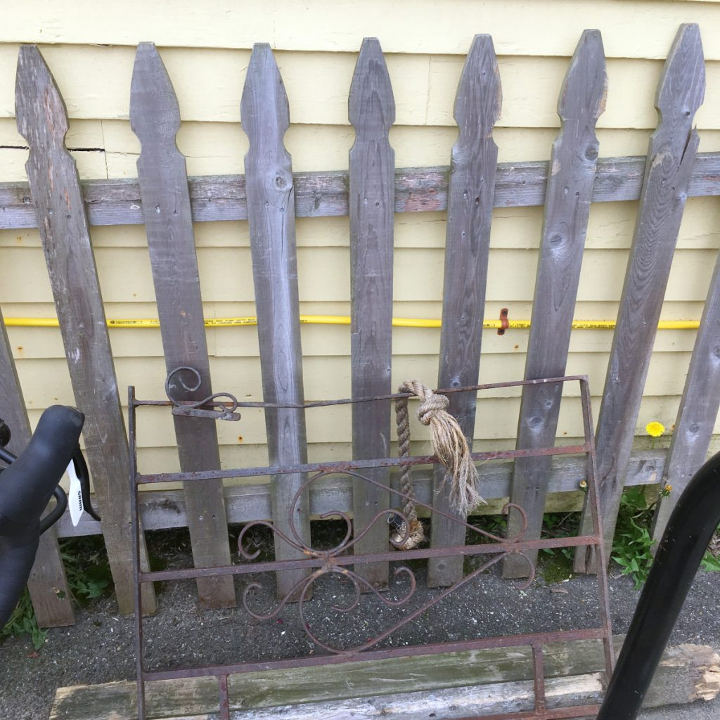 A picket fence and small metal gate section, knocked over by a vehicle this past weekend, was moved and leaned against Slates Restaurant in Hallowell on Tuesday.