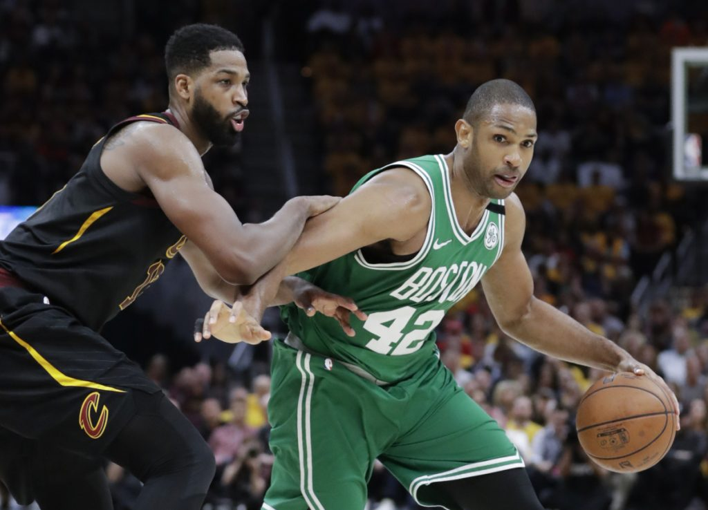 Boston Celtics forward Al Horford (42) drives on Cleveland's Tristan Thompson in the second half of Game 4 of the Eastern Conference finals on Monday in Cleveland.