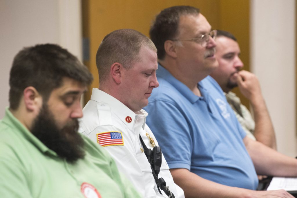 Waterville fire Captain Shawn Esler, second from left, sits with Chief Dave LaFountain, second from right, during a budget workshop Wednesday at the City Council Chambers at The Center in Waterville. Esler has been named new fire chief and will take over when LaFountain retires June 30.