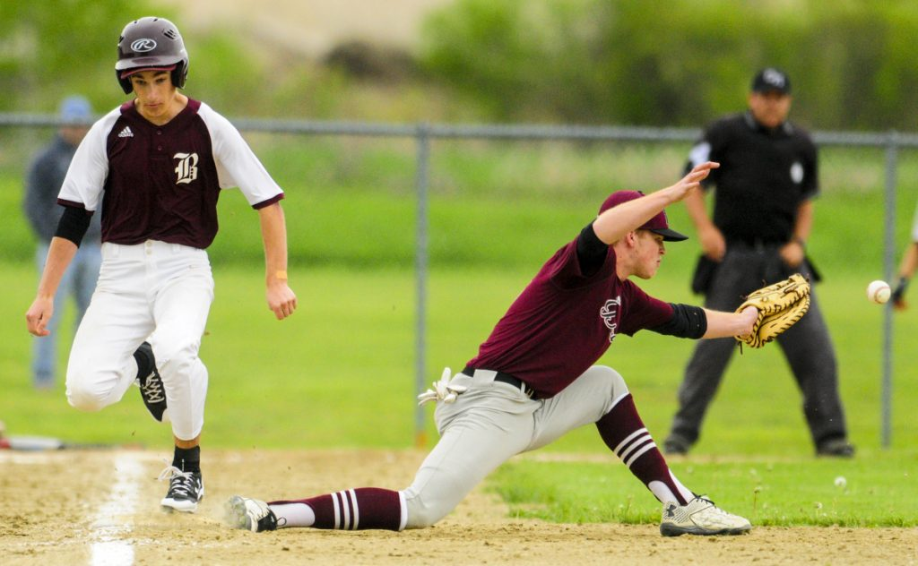 Buckfield's Shane St. Pierre, left, beats out the throw to first baseman Danny Stewart during a game on Tuesday on the Gerald N. Seigars Memorial Baseball Field in Richmond. The Bucks scored two runs on the play.