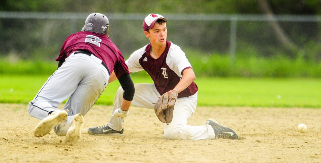 Richmond baserunner Matt Rines, left, dives back to second base in time to beat the throw to Buckfield second baseman Dylan Harvey during a game Tuesday on the Gerald N. Seigars Memorial Baseball Field in Richmond.