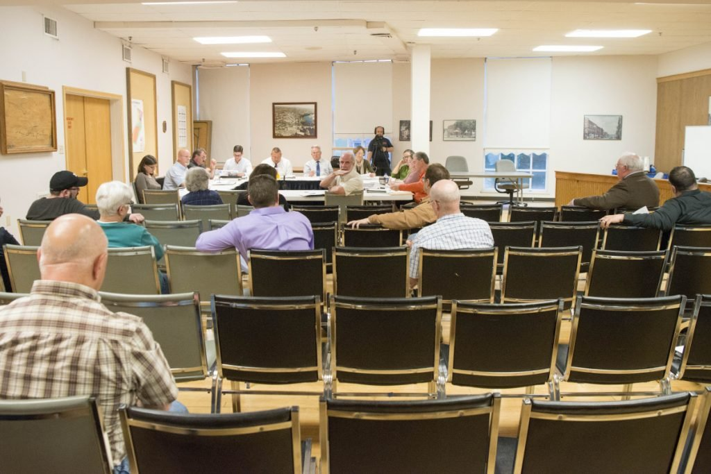 Residents listen during a budget workshop Tuesday at the City Council Chambers at The Center in Waterville.