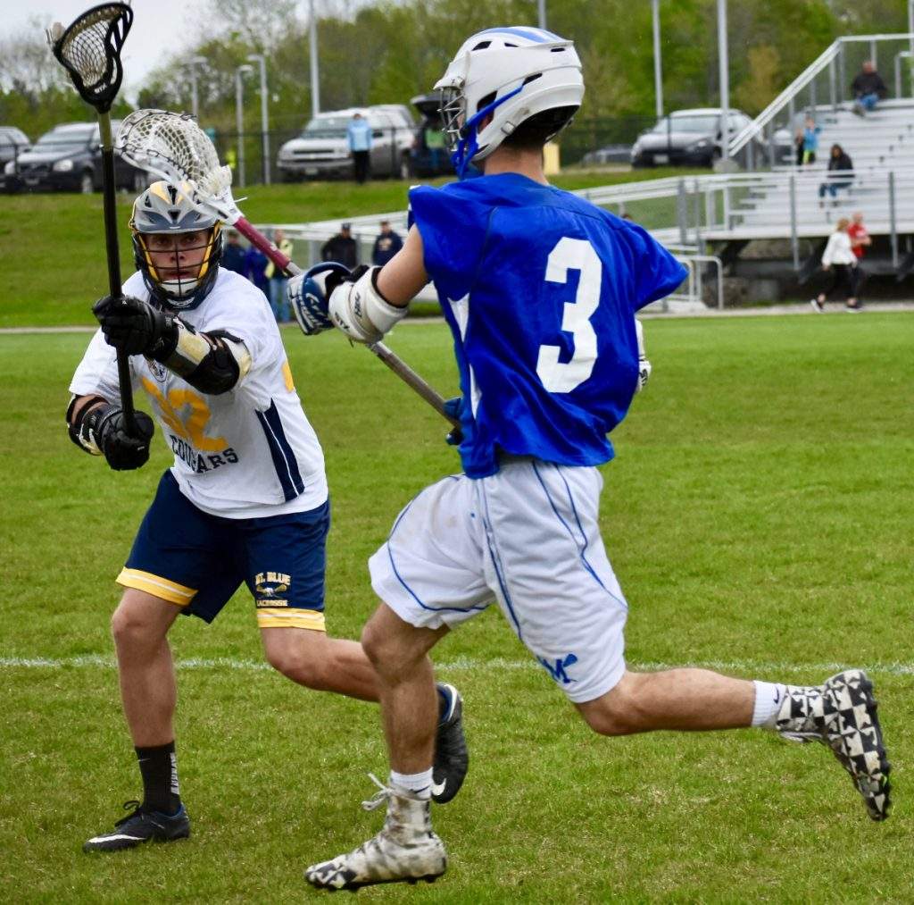 Morse's Don Green tries to race by Dominique Giampietro (32) in a lacrosse game at Caldwell Field in Farmington on Tuesday afternoon.