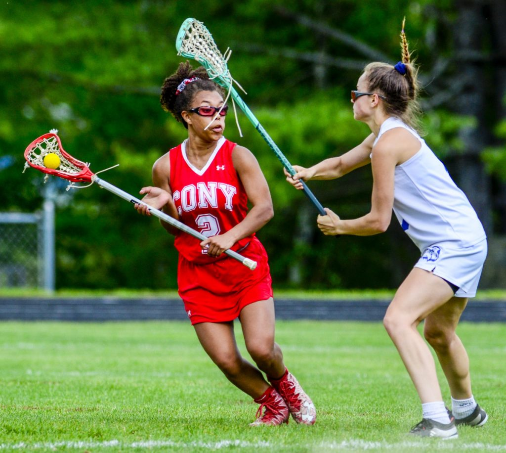 Cony's Kami Lambert, left, tries to get past Erskine Academy's Olivia Kunesh during a game Wednesday in South China.