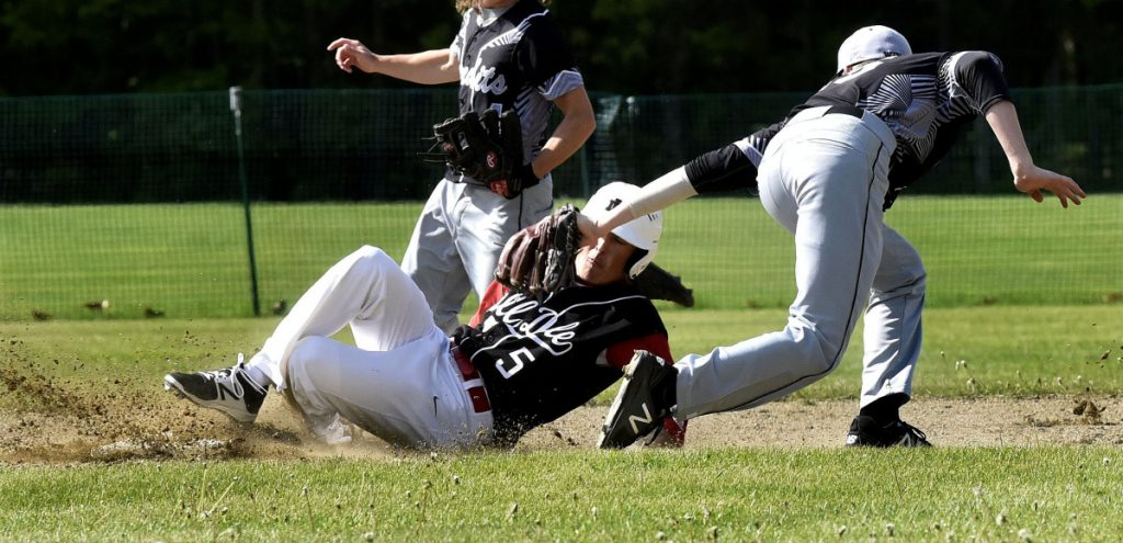 Bridgeway's Evan Holzworth tries to tag out Hall-Dale's Austin Stebbins on Wednesday in North Anson.
