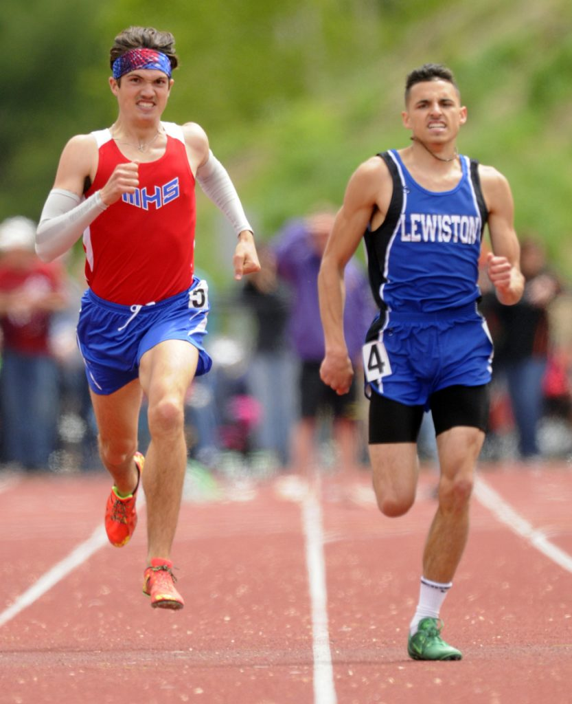 Messalonskee's Zach Hoyle, left, and Lewiston's Ethan Solis sprint to the finish line in the 400 meters during the Class A state track and field meet last year at Massabesic High School in Waterboro.