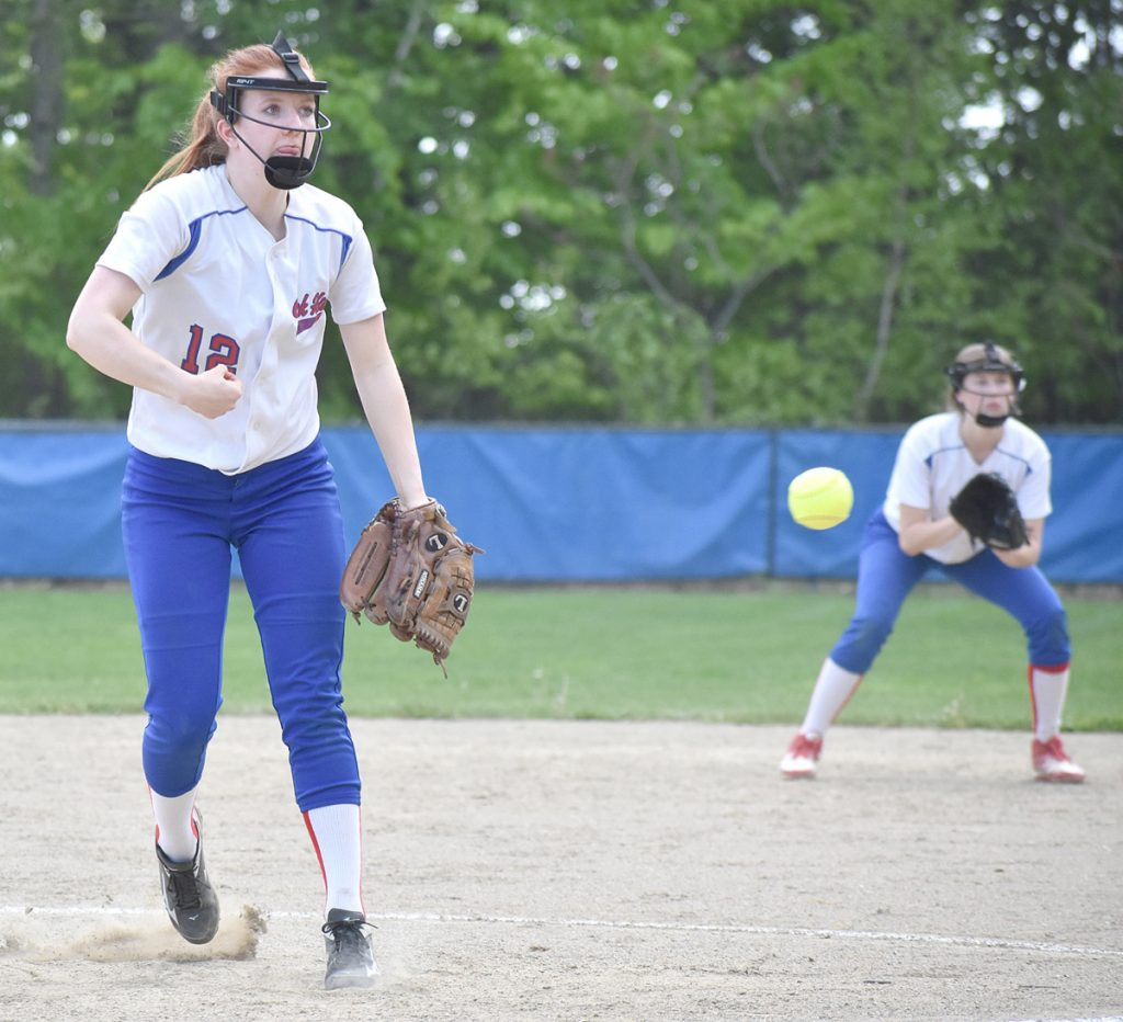 Oak Hill starting pitcher Sadie Waterman delivers a pitch while second baseman Emily Ahlberg looks on during a win over Spruce Mountain in Wales on Wednesday.
