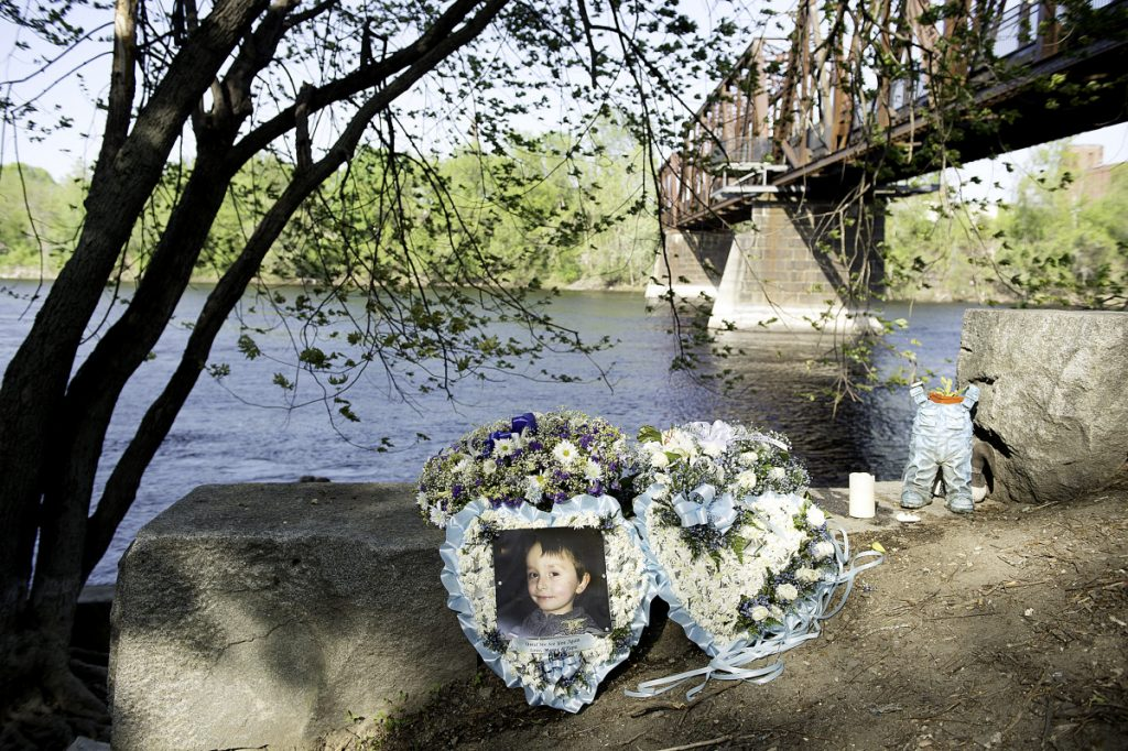 A picture of 5-year-old Valerio McFarland rests near where he fell into the Androscoggin River on April 24.