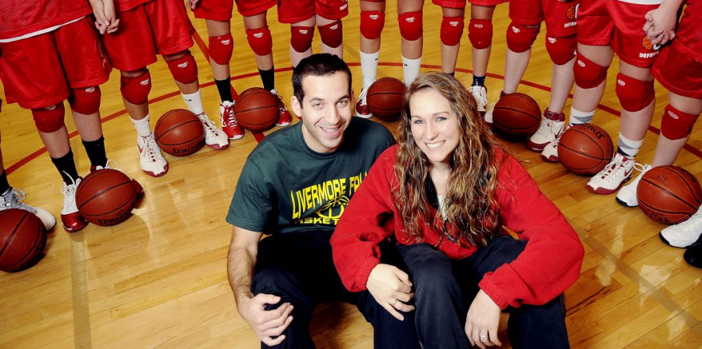 Travis Magnusson poses with his wife, Karen, at Cony High School in January 2011. Magnusson is the new Mt. Blue boys basketball coach.