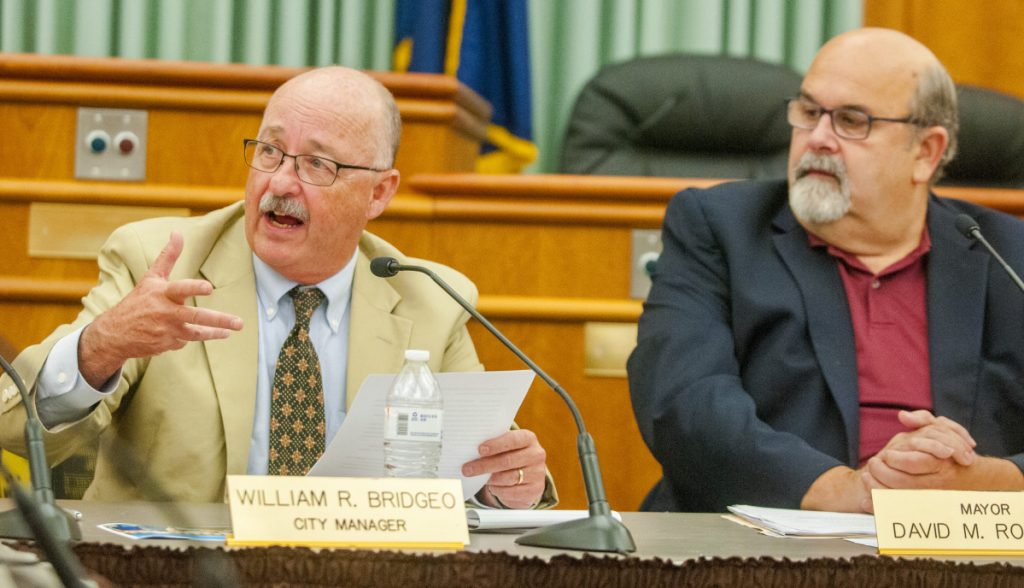 City Manager William Bridgeo, left, seen during a City Council meeting in July 2017, has worked with councilors to trim spending requests from a $63 million proposed budget. Mayor David Rollins, right, has raised concerns about trimming $25,000 from the parks and cemeteries budget in light of landscaping needs in certain areas of Augusta.