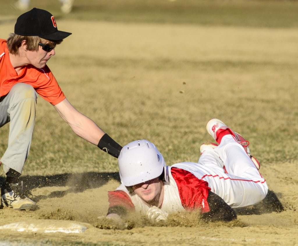 Gardiner first baseman Alic Shorey tags out Cony baserunner Mike Boivin before he can get back to the bag during a game earlier this season in Gardiner.
