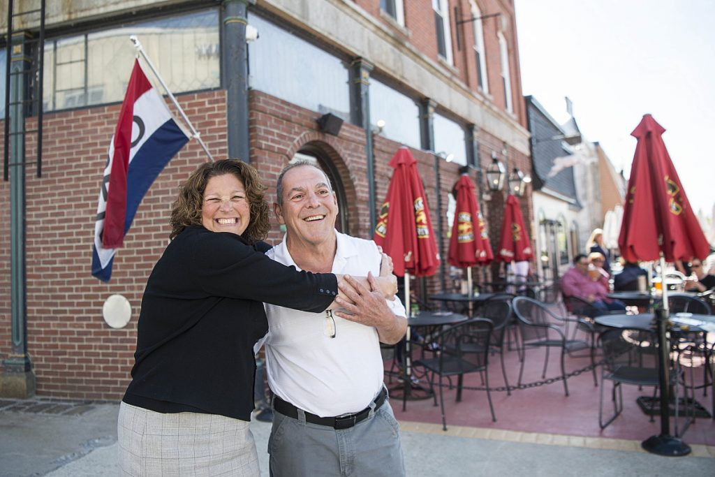 Buffy Higgins, former vice chairwoman for the board of directors of Waterville Main Street, stands for a picture with local business owner Charlie Giguere outside Giguere's Silver Street Tavern recently.