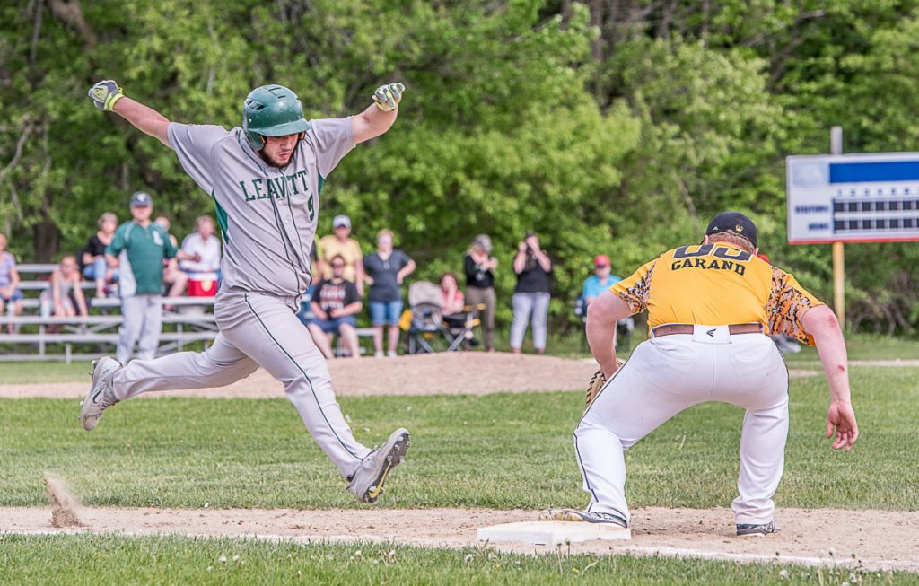 Maranacook's Dan Garand holds onto the ball and forces out a Leavitt baserunner during the baseball game in Turner on Friday afternoon.