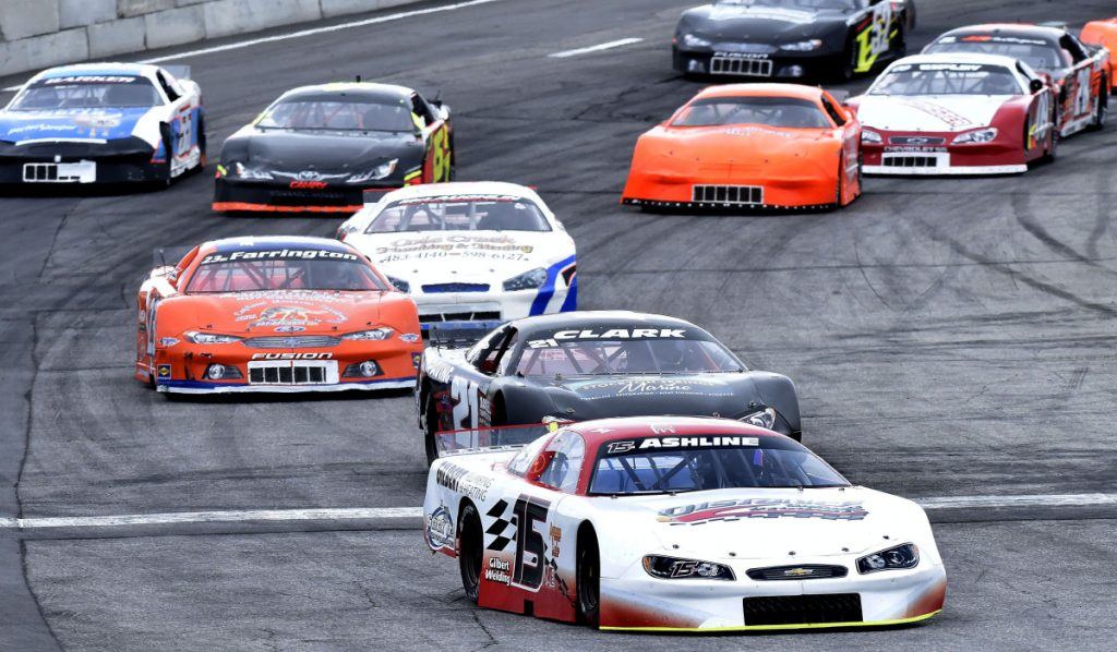 Staff photo by David Leaming   Ben Ashline (15) leads the pack during the Coastal 200 race Sunday at Wiscasset Speedway.
