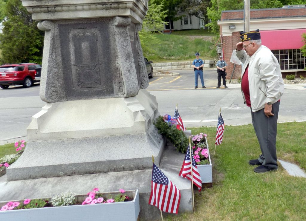 Sunday afternoon, Memorial Day Services were held in Wilton. Korean War veteran Skip Thompson salutes after placing a wreath at the monument on Main Street.