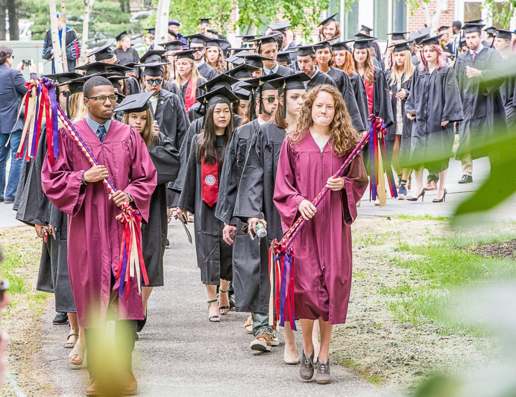 Bates College seniors march onto the quad for their graduation on Sunday morning in Lewiston.