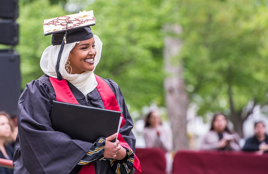 Rakiya Mohamed, from Auburn, smiles at the crowd after giving the senior address at the  Bates College graduation on Sunday morning.