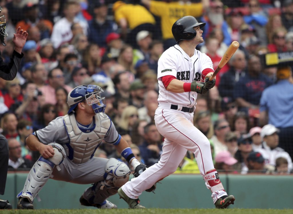 Boston's Andrew Benintendi, right, watches his three-run home run in front of Toronto catcher Luke Maile in the fourth inning Monday at Fenway Park in Boston.